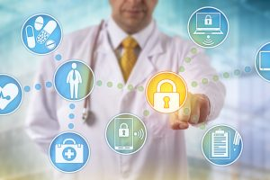 Unrecognizable_doctor_of_medicine_securing_patient_medical_records_across_multiple_devices_via_a_computer_network._Healthcare_IT_concept_for_security_of_health_information_exchange_and_data_privacy.