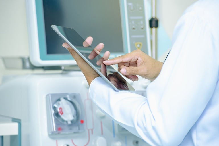 Medical_technology_or_medical_network._doctor_using_digital_tablet_with_screen_interface,medical_technology_network_concept,Medicine_doctor_and_stethoscope_in_hand_touching_icon_medical_network_connection_with_modern_screen_interface.