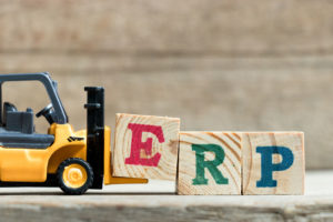 Toy_yellow_forklift_hold_letter_block_E_to_complete_word_ERP_(Abbreviation_of_Enterprise_Resource_Planning)on_wood_background