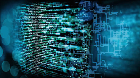 Programmiercode_mit_abstraktem_technischen_Hintergrund_in_blau