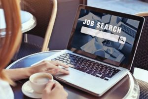 job_search_concept,_find_your_career,_woman_looking_at_online_website