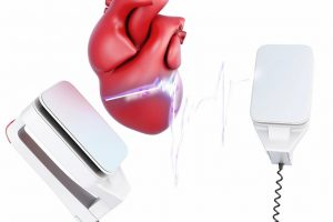Discharge_of_a_defibrillator_and_heart_isolated_on_white_background._3d_render_image.