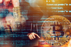 Computer_hacker_and_Bitcoin_cryptocurrency,_blockchain_technology_and_decentralized_monetary_system_concept