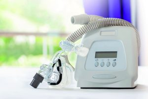 Sleep_apnea_therapy,CPAP_machine_with_mask_and_hose