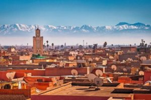 Panoramic_view_of_Marrakesh_and_the_snow_capped_Atlas_mountains,_Morocco