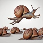 Concept_of_change_and_changing_to_better_compete_as_a_group_of_slow_racing_snails_with_one_individual_fast_leader_snail_with_running_limbs_as_a_business_idea_of_innovation_in_a_3D_illustration_style.